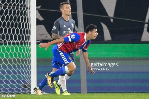 Basel's Paraguayan defender Blas Riveros runs past Benfica's Spanish defender Alejandro Grimaldo as he celebrates after scoring during the UEFA...