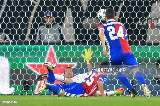 Basel's Paraguayan defender Blas Riveros scores a goal past Benfica's Brazilian goalkeeper Julio Cesar during the UEFA Champions League Group A...