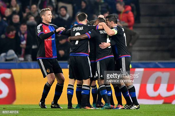 Basel's players celebrate after scoring a goal during the UEFA Champions League group A football match between FC Basel and Paris SaintGermain on...