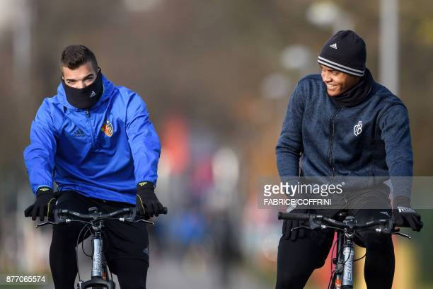 Basel's Portugese defender Pedro Pacheco and teammate Basel's Swiss defender Manuel Akanji arrive with their bicycles for a training session on the...