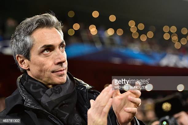 Basel's Portuguese head coach Paulo Sousa applauds prior to the UEFA Champions League round of 16 first leg football match between Basel and Porto on...