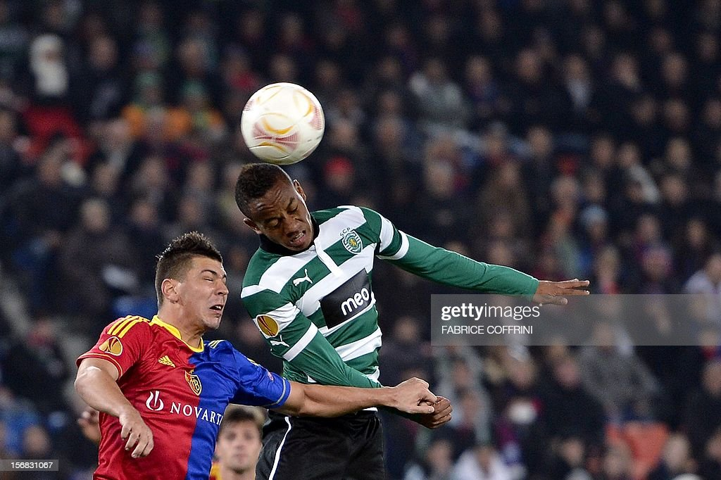 FC Basel's Serbian defender Aleksandar Dragovic (L) vies for the ball with Sporting's Peruvian forward Andre Carrillo during their Europa League UEFA Europa League Group G football match between FC Basel and Sporting Clube de Portugal on November 22, 2012 in Basel.