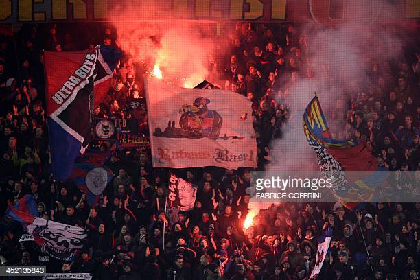 FC Basel's supporters celebrates their team's victory at the end of an UEFA Champions League group E football match FC Basel against Chelsea on...