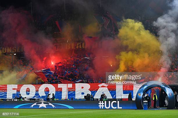 Basel's supporters cheer their team prior to the UEFA Champions League group A football match between FC Basel and Paris SaintGermain on November 1...