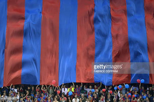 FC Basel's supporters cheer under a giant banner during an UEFA Europa League first leg semifinal football match between Basel and Chelsea at the St...