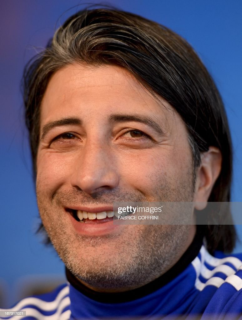 FC Basel's Swiss coach Murat Yakin smiles during a press conference in Basel on April 24, 2013, on the eve of the team's Europa League semi-final football match against Chelsea.