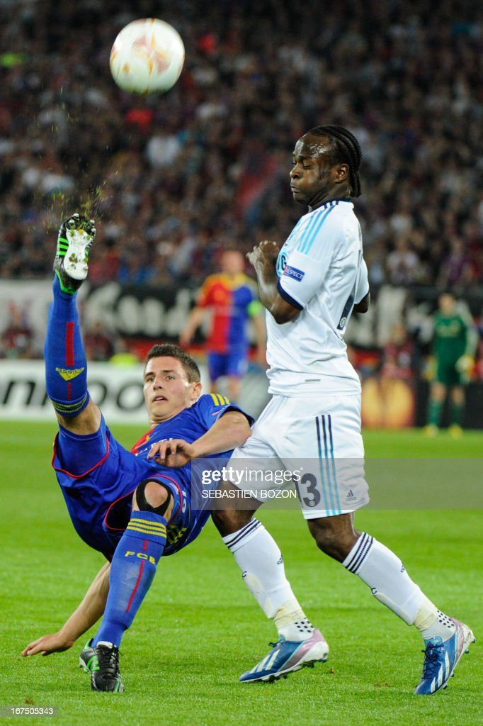 Basel's Swiss defender Fabian Schar (L) vies with Chelsea's Nigerian midfielder Victor Moses (R) during an UEFA Europa League first leg semi-final football match between Basel and Chelsea at the St Jakob stadium in Basel on April 25, 2013.