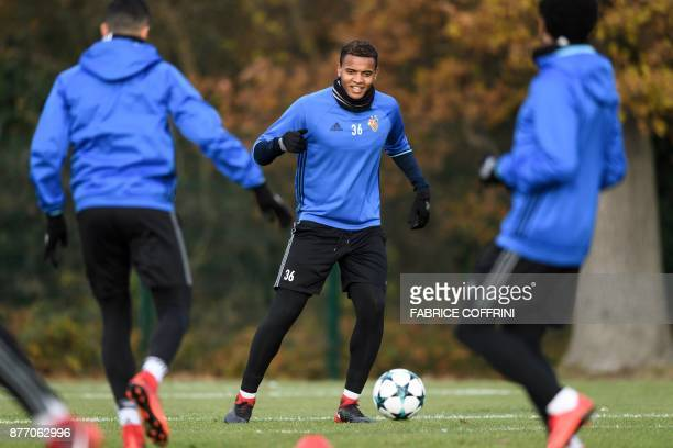 Basel's Swiss defender Manuel Akanji controls the ball during a training session on the eve of the UEFA Champions League Group A football match...