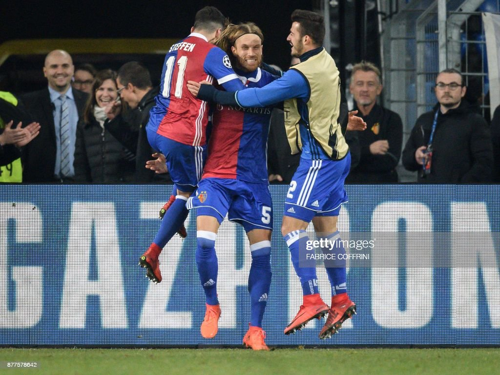 Basel's Swiss defender Michael Lang (C) celebrates with teammates after scoring a goal during the UEFA Champions League Group A football match between FC Basel and Manchester United on November 22, 2017 in Basel. / AFP PHOTO / Fabrice COFFRINI