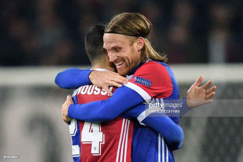 Basel's Swiss defender Michael Lang (R) who scored the only goal reacts at the end of the UEFA Champions League Group A football match between FC Basel and Manchester United on November 22, 2017 in Basel. / AFP PHOTO / Fabrice COFFRINI