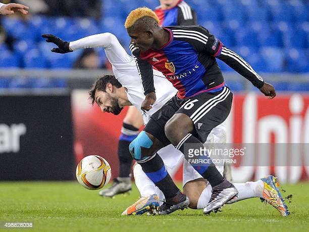 Basel's Swiss forward Breel Embolo challenges Fiorentina's Italian defender Davide Astori during the UEFA Europa League group I football match...