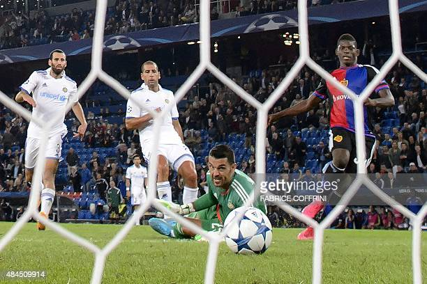 Basel's Swiss forward Breel Embolo scores the team's second goal against Maccabi's Spanish goalkeeper Juan Pablo during the UEFA Champions League...