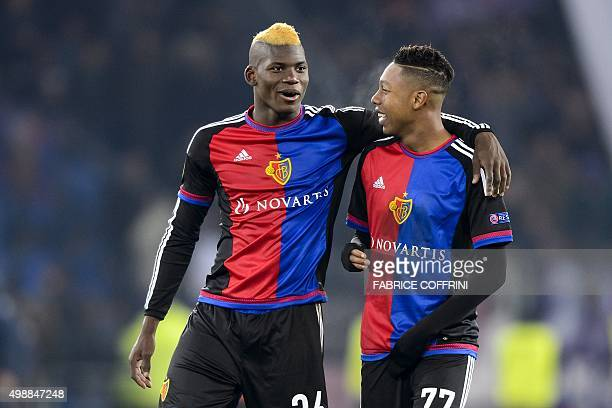 Basel's Swiss forward Breel Embolo speaks with teammatre JeanPaul Boetius during the UEFA Europa League group I football match between Basel and...