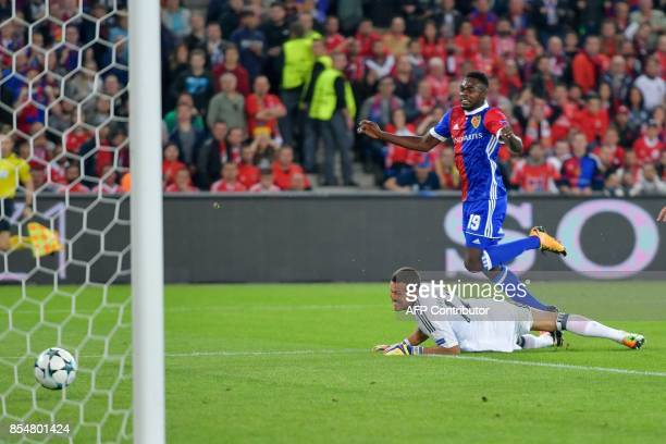 Basel's Swiss forward Dimitri Oberlin scores a goal against Benfica's Brazilian goalkeeper Julio Cesar during the UEFA Champions league Group A...