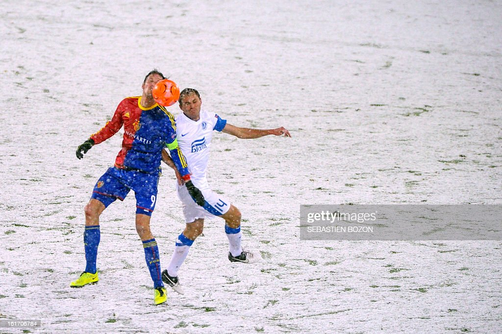 Basel's Swiss forward Marco Streller (L) vies with FC Dnipro's Ukrainian defender Yevhen Cheberyachko during an UEFA Europa League round of 32 football match FC Basel vs FC Dnipro at St-Jakob stadium in Basel, on February 14, 2013.