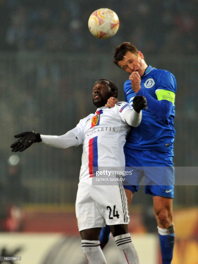 Basel's Swiss midfielder Adelson Cabral (L) fights for the ball with Dnipro Dnipropetrovsk's Ukrainian midfielder Ruslan Rotan during the UEFA Europa League, Round 32, football match between Dniepr Dnipropetrovsk and FC Basel on February 21, 2013 in Dnipropetrovsk, Ukraine. AFP PHOTO/ GENYA SAVILOV
