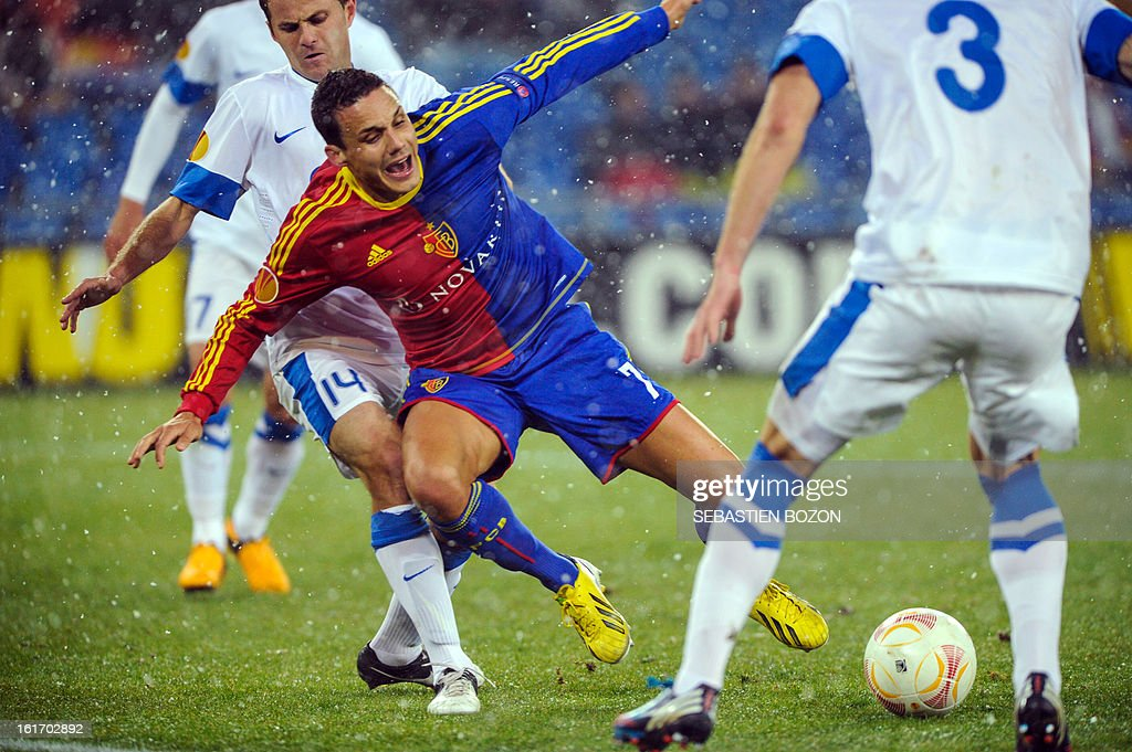 Basel's Swiss midfielder David Degen (2ndL) vies with FC Dnipro's Ukrainian defender Yevhen Cheberyachko (L) and FC Dnipro's Czech defender Ondrej Mazuch (R) during an UEFA Europa League round of 32 football match FC Basel vs FC Dnipro at St-Jakob stadium in Basel, on February 14, 2013.