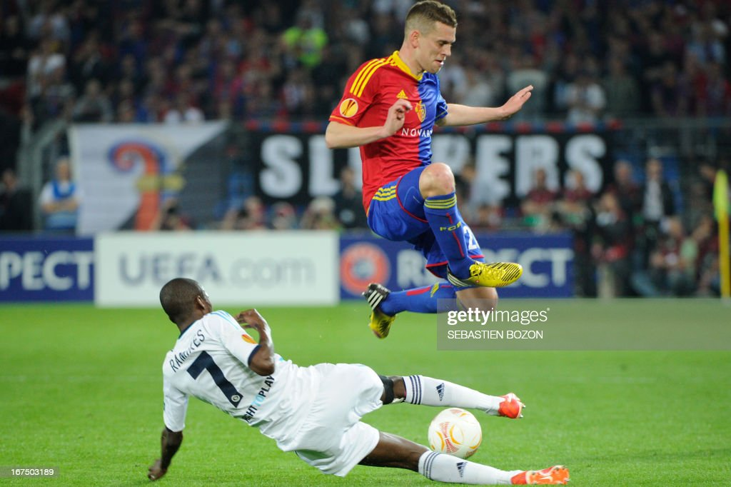 Basel's Swiss midfielder Fabian Frei (R) vies with Chelsea's Brazilian midfielder Ramires (L) during an UEFA Europa League first leg semi-final football match between Basel and Chelsea at the St Jakob stadium in Basel on April 25, 2013.