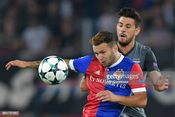 Basel's Swiss midfielder Renato Steffen and Benfica's midfielder Pizzi vies for the ball during the UEFA Champions league Group A football match...
