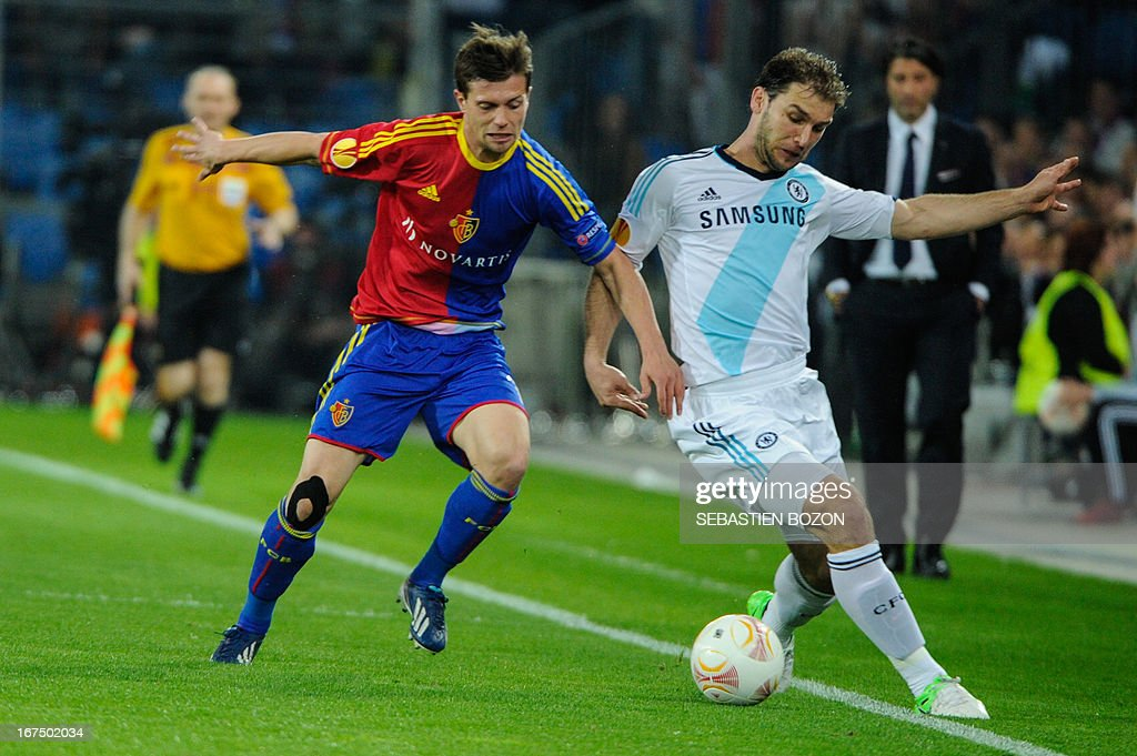 Basel's Swiss midfielder Valentin Stocker (L) vies with Chelsea's Serbian defender Branislav Ivanovic (R) during an UEFA Europa League first leg semi-final football match between Basel and Chelsea at the St Jakob stadium in Basel on April 25, 2013.