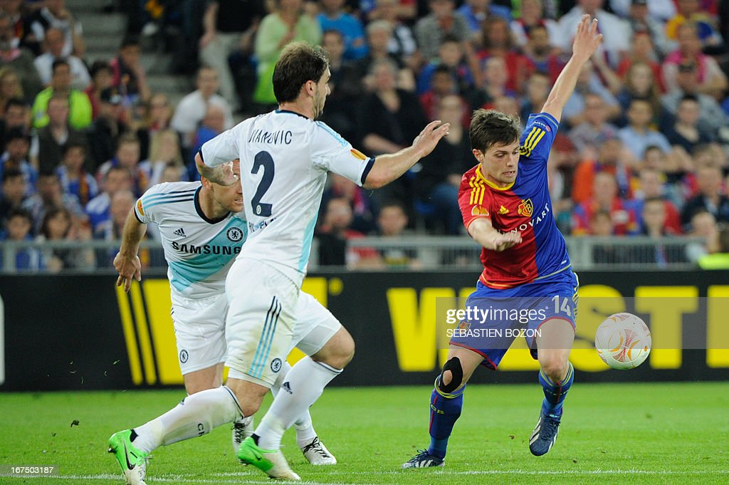 Basel's Swiss midfielder Valentin Stocker (R) vies with Chelsea's Serbian defender Branislav Ivanovic (2ndL) during an UEFA Europa League first leg semi-final football match between Basel and Chelsea at the St Jakob stadium in Basel on April 25, 2013.