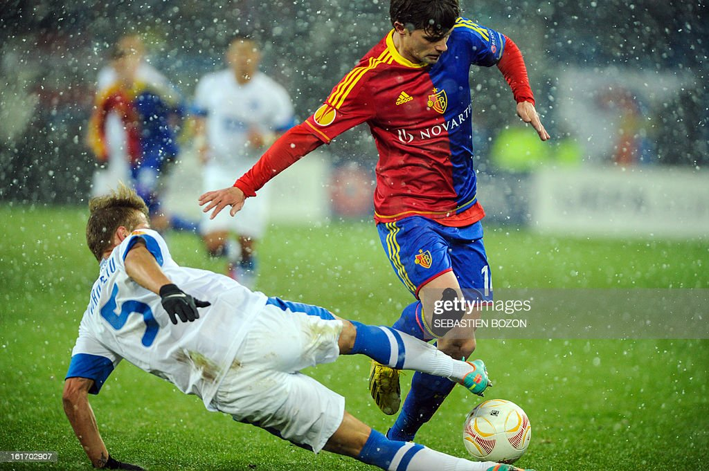 Basel's Swiss midfielder Valentin Stocker (R) vies with FC Dnipro's Ukrainian defender Vitaly Mandziuk (L) during an UEFA Europa League round of 32 football match FC Basel vs FC Dnipro at St-Jakob stadium in Basel, on February 14, 2013.