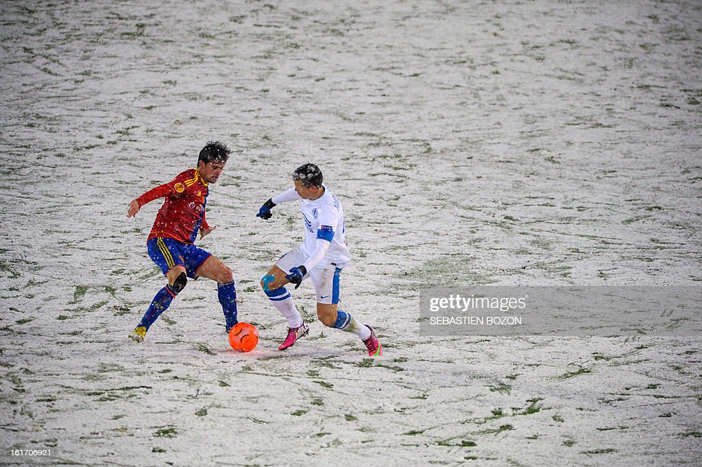 Basel's Swiss midfielder Valentin Stocker (L) vies with FC Dnipro's Ukrainian midfielder Yevhen Konoplyanka during an UEFA Europa League round of 32 football match FC Basel vs FC Dnipro at St-Jakob stadium in Basel, on February 14, 2013.