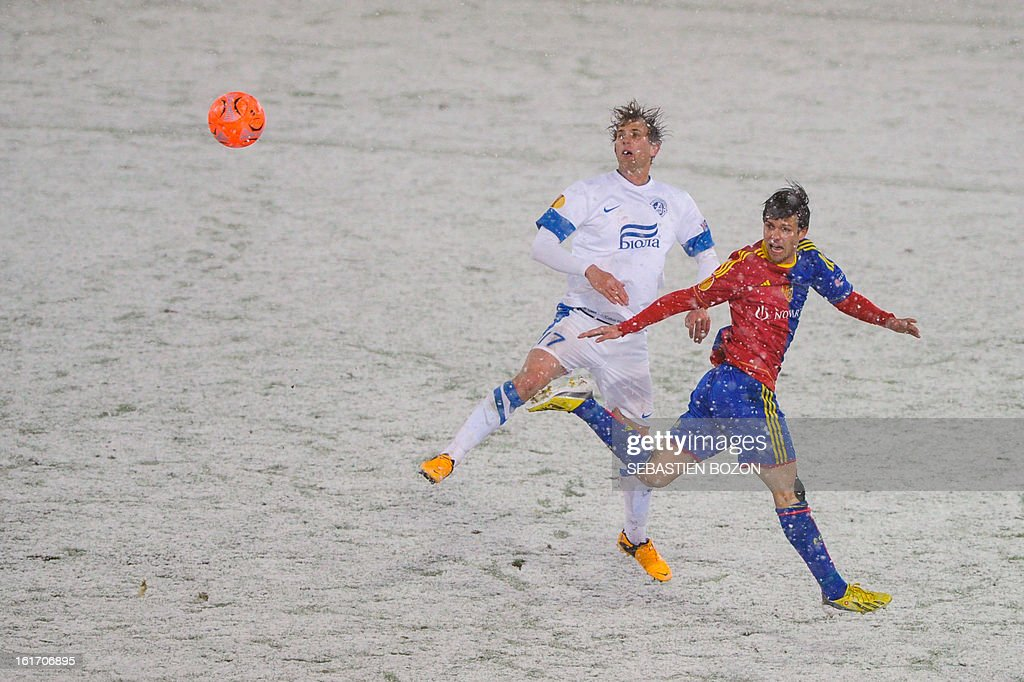 Basel's Swiss midfielder Valentin Stocker (R) vies with FC Dnipro's Ukrainian midfielder Denys Kulakov during an UEFA Europa League round of 32 football match FC Basel vs FC Dnipro at St-Jakob stadium in Basel, on February 14, 2013.