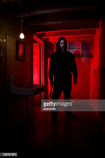 Basement Bathroom with Hooded Killer Holding Scary Knife, Copy Space