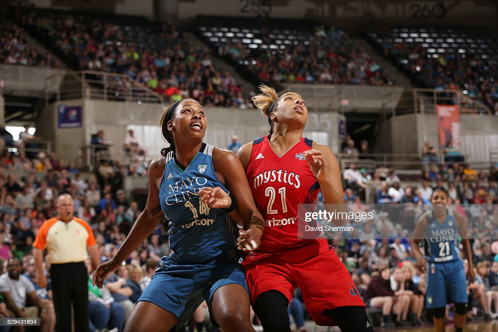 Bashaara Graves #14 of the Minnesota Lynx attempts to rebound the basketball against Tianna Hawkins #21 of the Washington Mystics during the preseason game on May 8, 2016 at the Mayo Civic Center in Rochester, Minnesota.