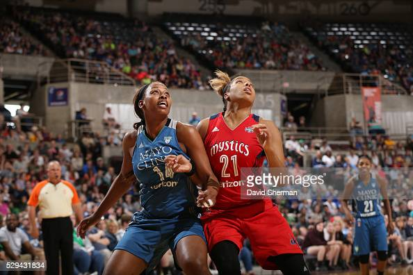 Bashaara Graves of the Minnesota Lynx attempts to rebound the basketball against Tianna Hawkins of the Washington Mystics during the preseason game...