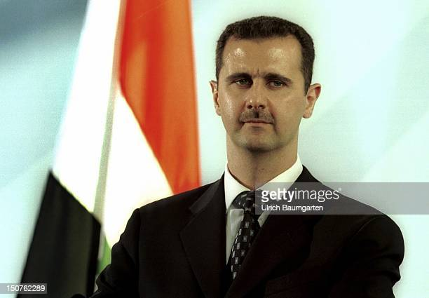 Bashar ALASSAD state president of Syria in front of the Syrian flag