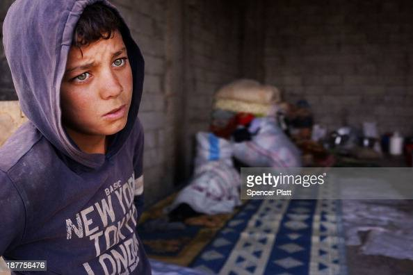 Bashar an 11 year old Syrian refugee stands near an empty garage he shares with members of his family only miles from the border with Syria in the...