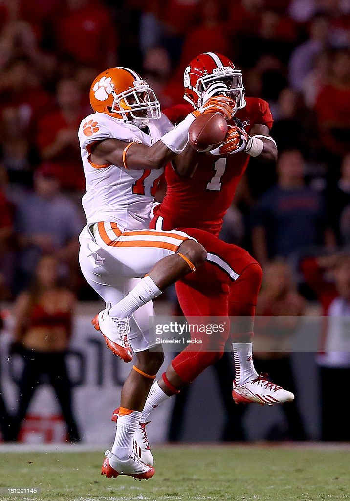 Bashaud Breeland #17 of the Clemson Tigers breaks up a pass to Marquez Valdes-Scantling #1 of the North Carolina State Wolfpack during their game at Carter-Finley Stadium on September 19, 2013 in Raleigh, North Carolina.