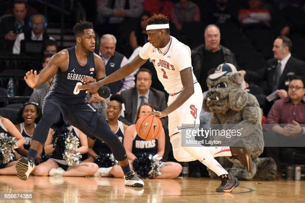 Bashir Ahmed of the St John's Red Storm dribbles the ball during the Big East Basketball Tournament First Round game against the Georgetown Hoyas at...