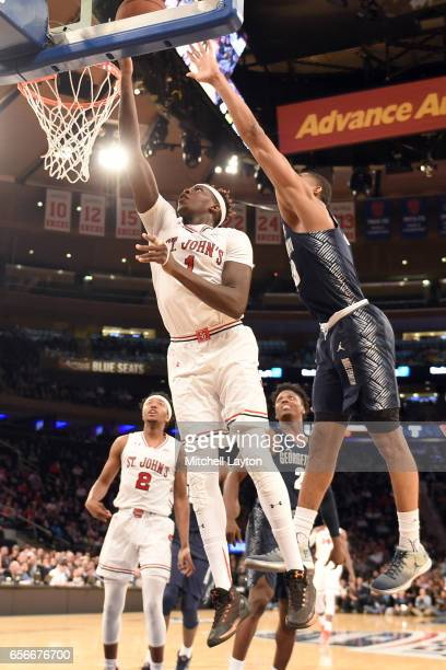 Bashir Ahmed of the St John's Red Storm drives to the basket during the Big East Basketball Tournament First Round game against the Georgetown Hoyas...