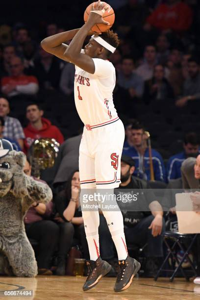Bashir Ahmed of the St John's Red Storm takes a jump shot during the Big East Basketball Tournament First Round game against the Georgetown Hoyas at...