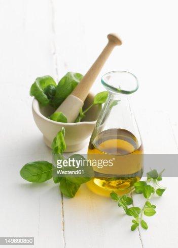 Basil and oregano leaf in mortar and pestle