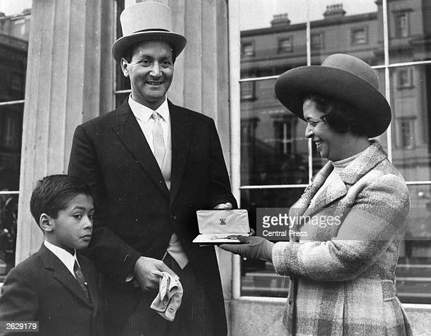 Basil Lewis D'Oliveira the South African born cricketer with his wife and son Damien at Buckingham Palace where he has just been presented with an...