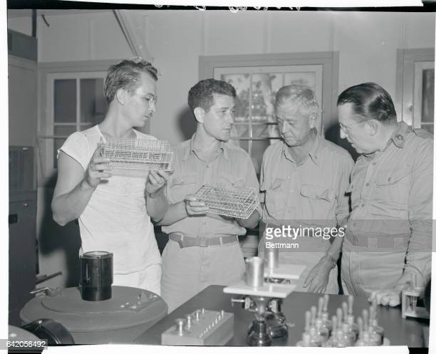 Basil O'Connor chairman of the American Red Cross is shown while visiting an experimental laboratory Others are left to right Ph Mate 1/c Steve Holt...