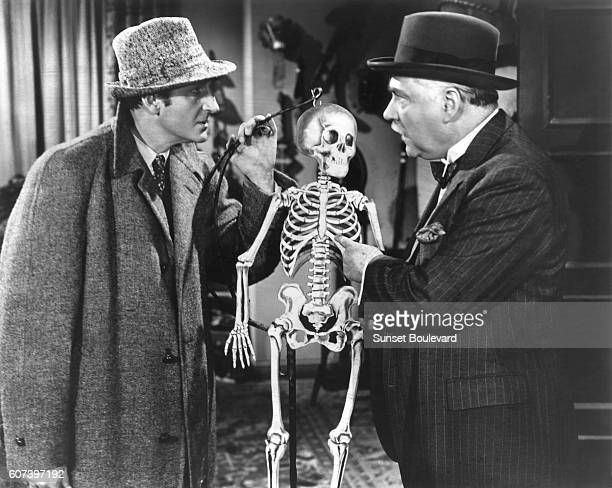 Basil Rathbone and Nigel Bruce on the set of 'Spider Woman'