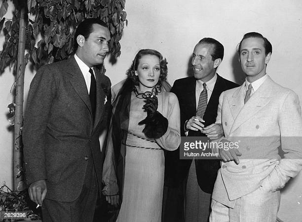 Basil Rathbone British actor meets fellow stars Marlene Dietrich Edward Eily and Count Capagna Rathbone starred in a number of British films but is...