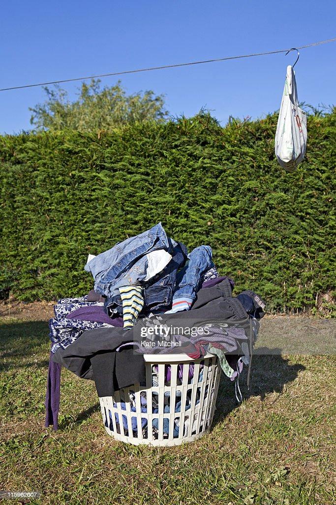 Basket full of laundry : Stock Photo