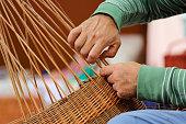 Close-up shot of basker maker hands at work