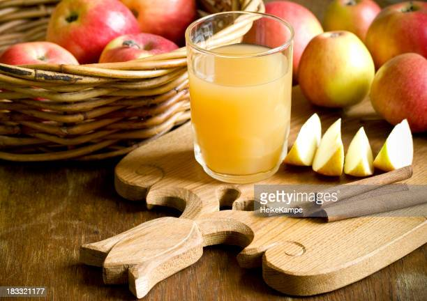 A basket of apples and apple juice