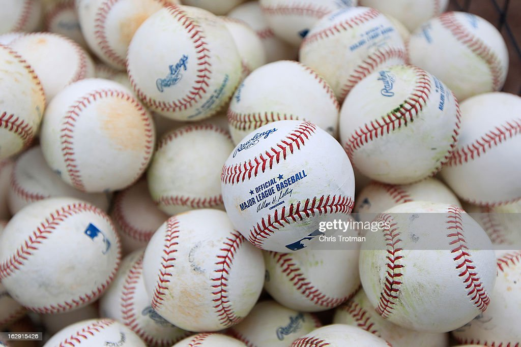 A basket of baseballs on the field during batting practice prior to the game between the Miami Marlins and the St. Louis Cardinals at the Roger Dean Stadium on February 28, 2013 in Jupiter, Florida.