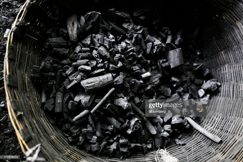 A basket of coal sits on the ground at a coal wholesale market in Mumbai, India, on Tuesday, July 2, 2013. India, the worlds third-largest coal consumer, imported 43 percent more of the fuel than a year ago on increased demand from power stations and steelmakers, according to shipping data, and is set to eclipse China as the top importer of power station coal by 2014. Photographer: Dhiraj Singh/Bloomberg via Getty Images