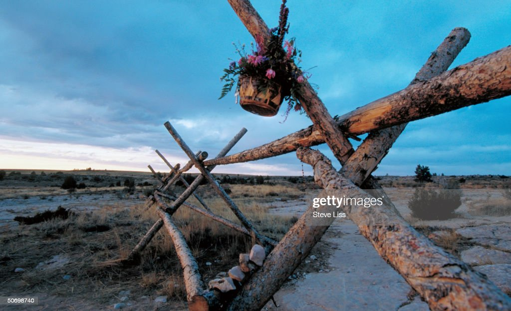 Basket of flowers hanging from fence where Matthew Shepard openly gay Univ of Wyoming student was left tied beaten near death in savage assault by...