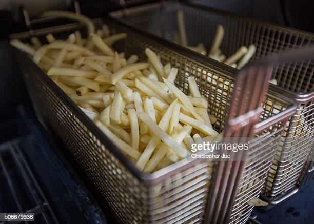 A basket of french fries which will be used for McChoco Potato is seen in the kitchen at a McDonald's Japan branch on January 25 2016 in Tokyo Japan...