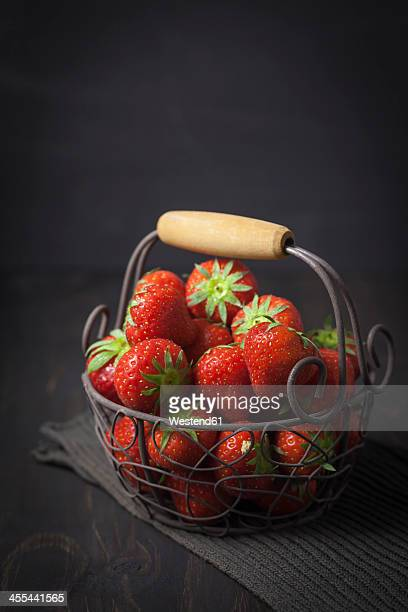 Basket of fresh strawberries on table, close up